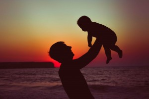 dad and baby in sunset